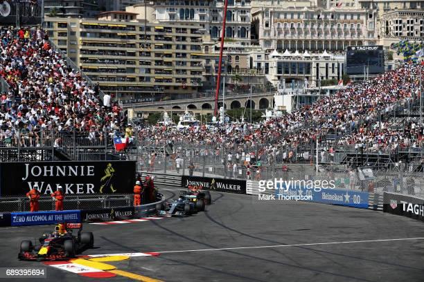 Daniel Ricciardo of Australia driving the Red Bull Racing Red Bull-TAG Heuer RB13 TAG Heuer leads Valtteri Bottas driving the Mercedes AMG Petronas...