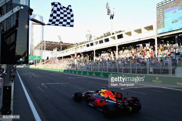 Daniel Ricciardo of Australia driving the Red Bull Racing Red BullTAG Heuer RB13 TAG Heuer takes the chequered flag and the win during the Azerbaijan...