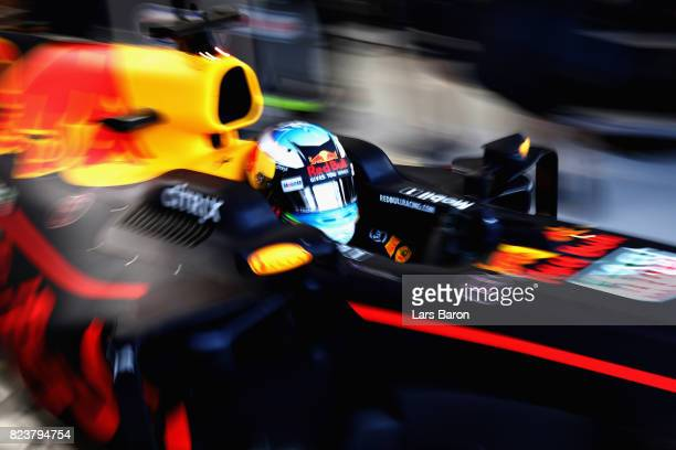 Daniel Ricciardo of Australia driving the Red Bull Racing Red BullTAG Heuer RB13 TAG Heuer leaves the garage during practice for the Formula One...