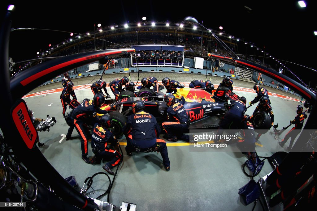 Daniel Ricciardo of Australia driving the (3) Red Bull Racing Red Bull-TAG Heuer RB13 TAG Heuer makes a pit stop for new tyres during the Formula One Grand Prix of Singapore at Marina Bay Street Circuit on September 17, 2017 in Singapore.
