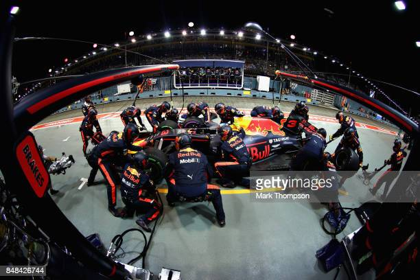 Daniel Ricciardo of Australia driving the Red Bull Racing Red BullTAG Heuer RB13 TAG Heuer makes a pit stop for new tyres during the Formula One...