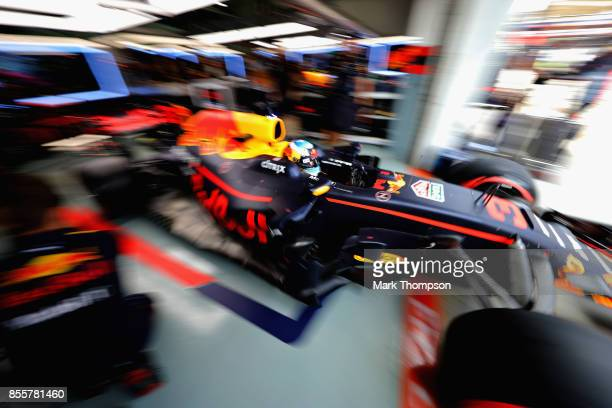 Daniel Ricciardo of Australia driving the Red Bull Racing Red BullTAG Heuer RB13 TAG Heuer leaves the garage during qualifying for the Malaysia...