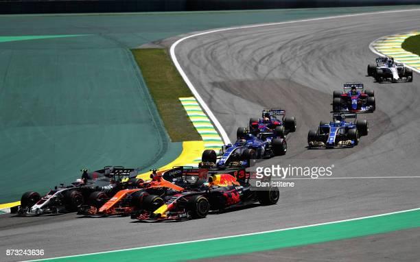 Daniel Ricciardo of Australia driving the Red Bull Racing Red BullTAG Heuer RB13 TAG Heuer Stoffel Vandoorne of Belgium driving the McLaren Honda...