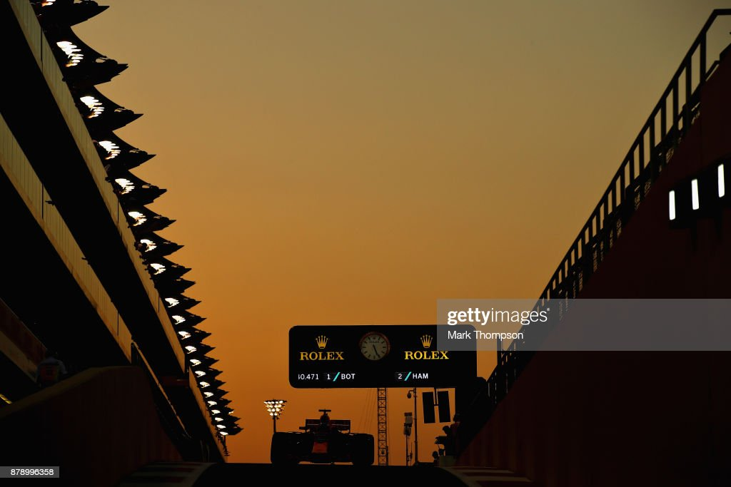 Daniel Ricciardo of Australia driving the (3) Red Bull Racing Red Bull-TAG Heuer RB13 TAG Heuer in the Pitlane during qualifying for the Abu Dhabi Formula One Grand Prix at Yas Marina Circuit on November 25, 2017 in Abu Dhabi, United Arab Emirates.