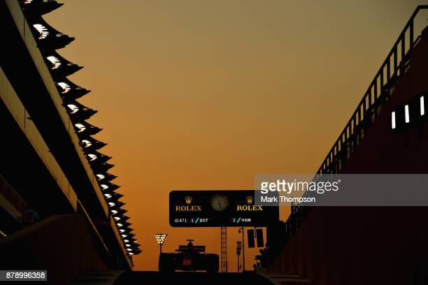 Daniel Ricciardo of Australia driving the Red Bull Racing Red BullTAG Heuer RB13 TAG Heuer in the Pitlane during qualifying for the Abu Dhabi Formula...