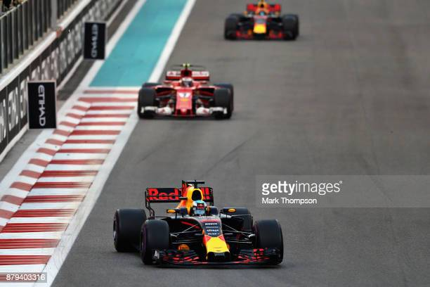 Daniel Ricciardo of Australia driving the Red Bull Racing Red BullTAG Heuer RB13 TAG Heuer leads Kimi Raikkonen of Finland driving the Scuderia...