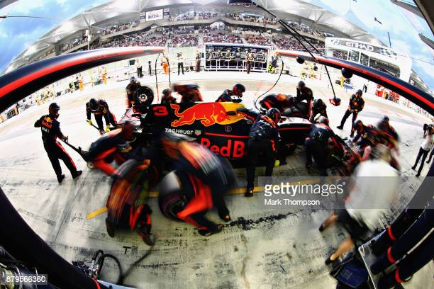 Daniel Ricciardo of Australia driving the Red Bull Racing Red BullTAG Heuer RB13 TAG Heuer makes a pit stop during the Abu Dhabi Formula One Grand...