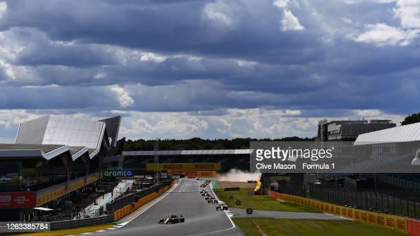 Daniel Ricciardo of Australia driving the Renault Sport Formula One Team RS20 as Kevin Magnussen of Denmark driving the Haas F1 Team VF20 Ferrari...