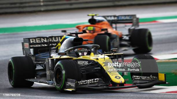 Daniel Ricciardo of Australia driving the Renault Sport Formula One Team RS20 leads Lando Norris of Great Britain driving the McLaren F1 Team MCL35...