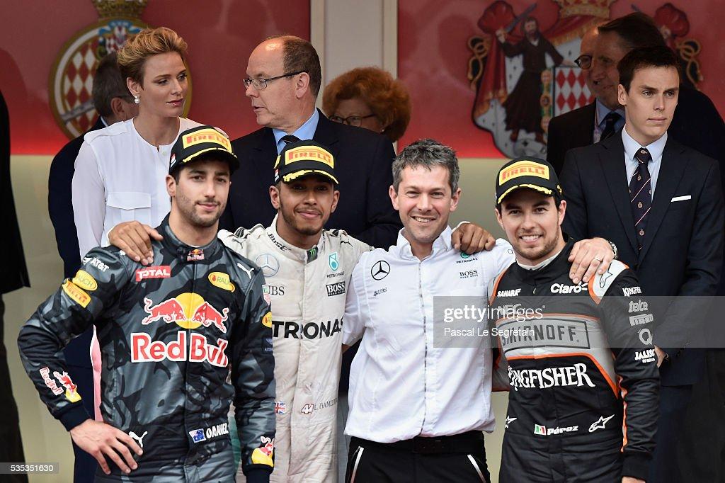 Daniel Ricciardo of Australia, Lewis Hamilton of Great Britain, guest and Sergio Perez of Mexico pose on the podium after winning the F1 Grand Prix of Monaco on May 29, 2016 in Monte-Carlo, Monaco.