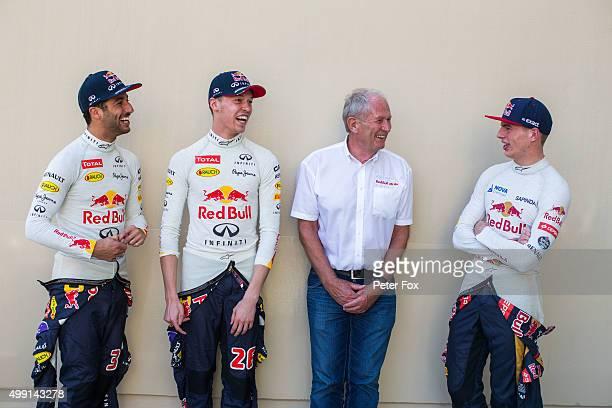 Daniel Ricciardo of Australia with Daniil Kvyat of Russia both of Infiniti Red Bull Racing with Helmut Marko of Austria and Infiniti Red Bull Racing...