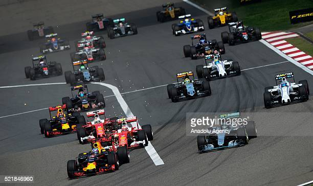 Daniel Ricciardo of Red Bull Racing leads Nico Rosberg of Mercedes AMG Petronas at the start during the Formula One Grand Prix of China at Shanghai...