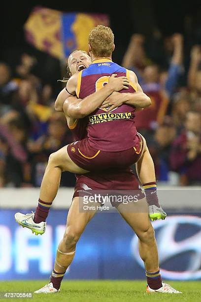 Daniel Rich and Josh Green of the Lions celebrate a goal during the round seven AFL match between the Brisbane Lions and the Port Adelaide Power at...