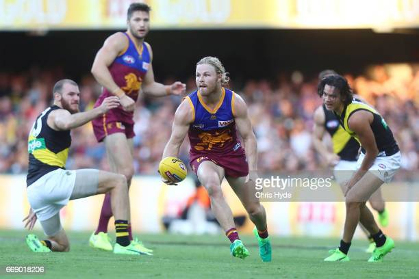Daniel Rich of the Lions handballs during the round four AFL match between the Brisbane Lions and the Richmond Tigers at The Gabba on April 16 2017...