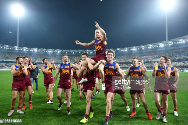 Daniel Rich of the Lions is chaired off after his 200th match during the round 18 AFL match between the Brisbane Lions and the North Melbourne...