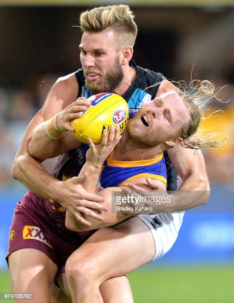 Daniel Rich of the Lions is tackled by Jackson Trengove of the Power during the round six AFL match between the Brisbane Lions and the Port Adelaide...