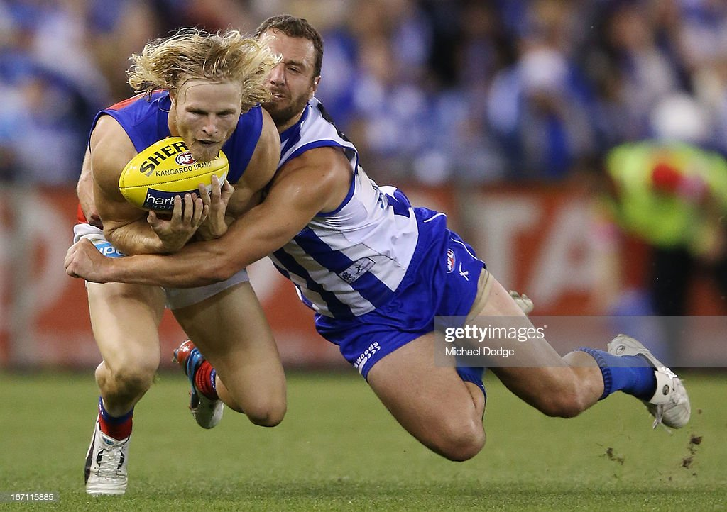 Daniel Rich of the Lions marks the ball against Scott McMahon of the Kangaroos during the round four AFL match between the North Melbourne Kangaroos and the Brisbane Lions at Etihad Stadium on April 21, 2013 in Melbourne, Australia.