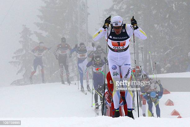 Daniel Rickardsson of Sweden leads the field in the Men's Cross Country 4x10km Relay race during the FIS Nordic World Ski Championships at...