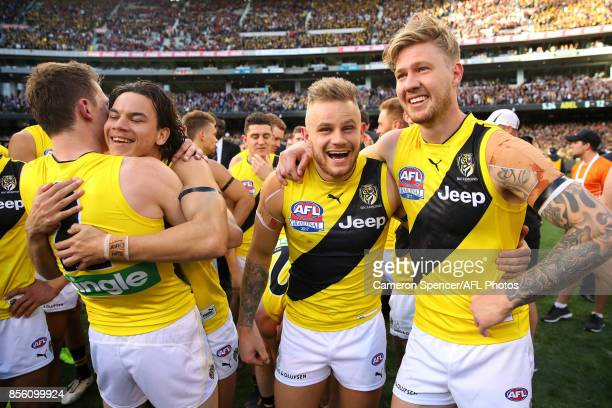 Daniel Rioli Brandon Ellis and Nathan Broad of the Tigers celebrate winning the 2017 AFL Grand Final match between the Adelaide Crows and the...