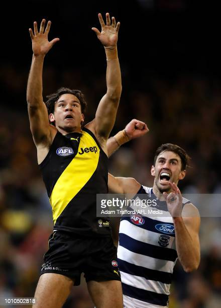 Daniel Rioli of the Tigers and Debutant Ryan Abbott of the Cats compete for the ball during the 2018 AFL round 20 match between the Richmond Tigers...
