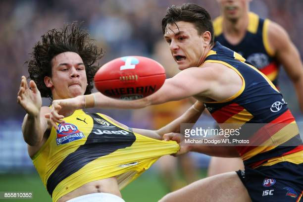Daniel Rioli of the Tigers and Jake Lever of the Crows compete for the ball during the 2017 AFL Grand Final match between the Adelaide Crows and the...