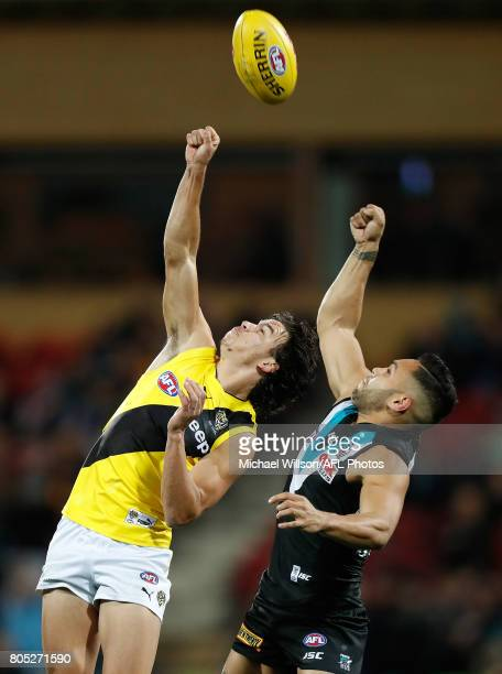 Daniel Rioli of the Tigers and Jarman Impey of the Power compete for the ball during the 2017 AFL round 15 match between the Port Adelaide Power and...