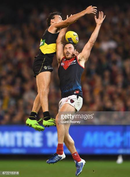 Daniel Rioli of the Tigers and Michael Hibberd of the Demons compete for the mark during the round five AFL match between the Richmond Tigers and the...