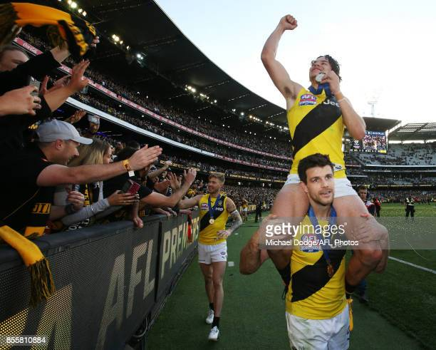 Daniel Rioli of the Tigers celebrates the win on Trent Cotchin during the 2017 AFL Grand Final match between the Adelaide Crows and the Richmond...