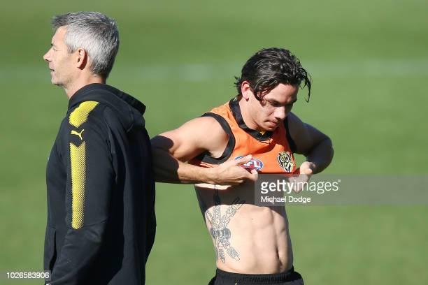 Daniel Rioli of the Tigers changes tops during a Richmond Tigers AFL training session at Punt Road Oval on September 4 2018 in Melbourne Australia