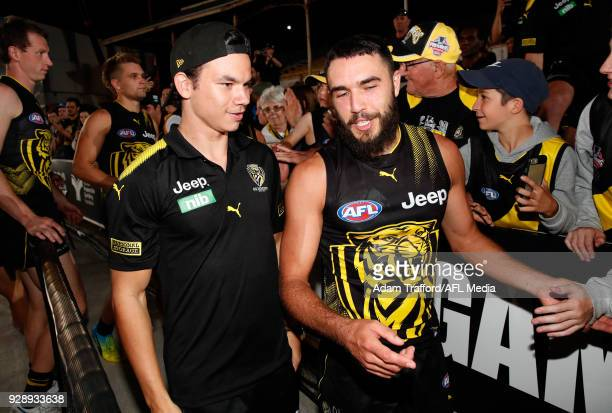 Daniel Rioli of the Tigers chats to Shane Edwards of the Tigers during the AFL 2018 JLT Community Series match between the Richmond Tigers and the...