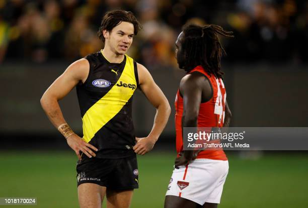 Daniel Rioli of the Tigers chats with Anthony McDonaldTipungwuti of the Bombers during the 2018 AFL round 22 match between the Richmond Tigers and...