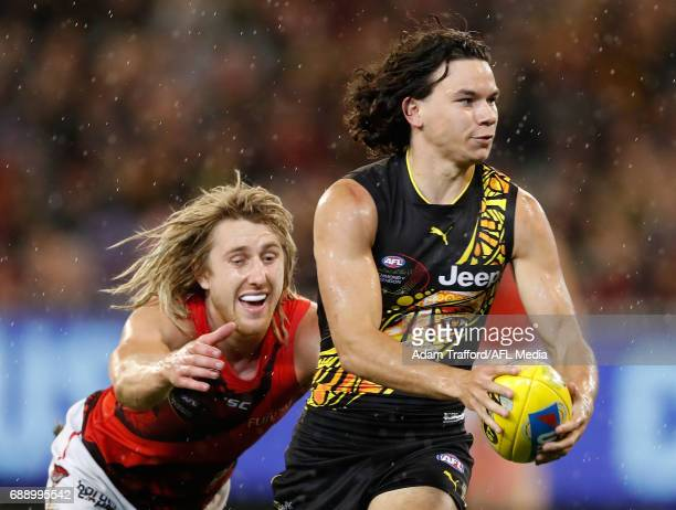 Daniel Rioli of the Tigers is tackled by Dyson Heppell of the Bombers during the 2017 AFL round 10 Dreamtime at the G match between the Richmond...