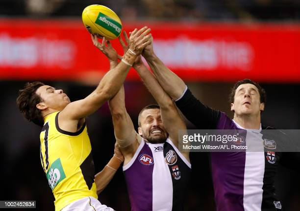 Daniel Rioli of the Tigers Jarryn Geary of the Saints and Jake Carlisle of the Saints compete for the ball during the 2018 AFL round 18 match between...