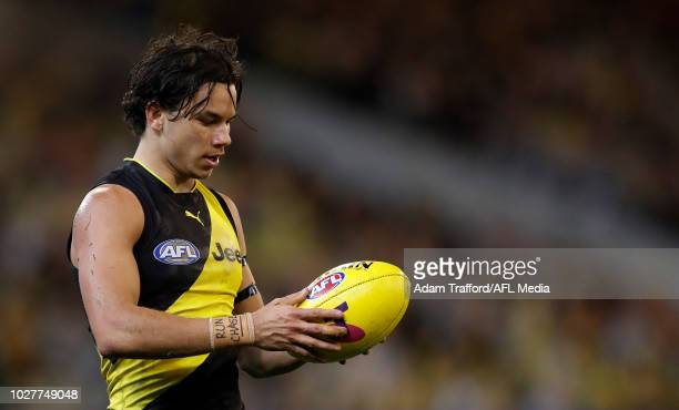 Daniel Rioli of the Tigers looks at the ball during the 2018 AFL First Qualifying Final match between the Richmond Tigers and the Hawthorn Hawks at...