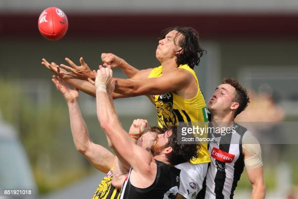 Daniel Rioli of the Tigers marks the ball during the 2017 JLT Community Series AFL match between the Richmond Tigers and the Collingwood Magpies at...