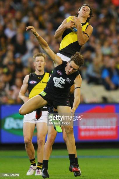 Daniel Rioli of the Tigers marks the ball over Patrick Cripps of the Blues during the round one AFL match between the Carlton Blues and the Richmond...