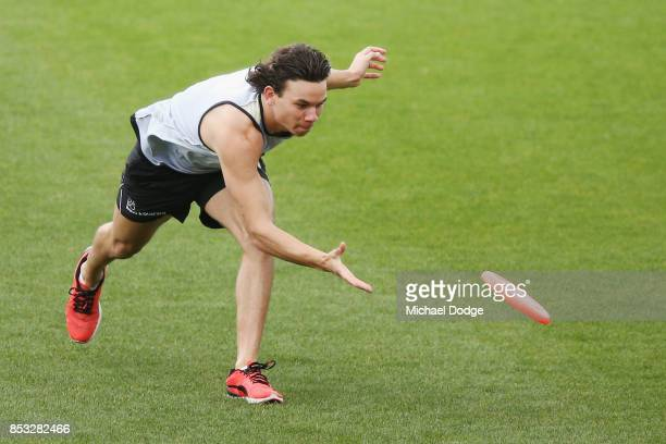 Daniel Rioli of the Tigers plays with a frisby during a Richmond Tigers AFL media oportunity at Punt Road Oval on September 25 2017 in Melbourne...