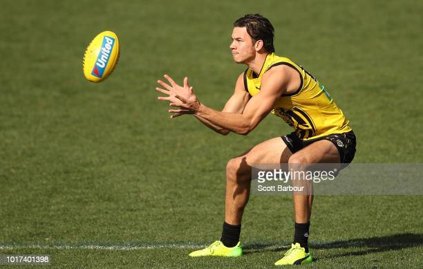 Daniel Rioli of the Tigers runs with the ball during a Richmond Tigers AFL training session at Punt Road Oval on August 16 2018 in Melbourne Australia
