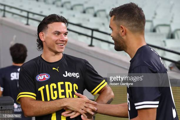 Daniel Rioli of the Tigers shakes hands with Jack Martin of the Blues prior to the round 1 AFL match between the Richmond Tigers and the Carlton...