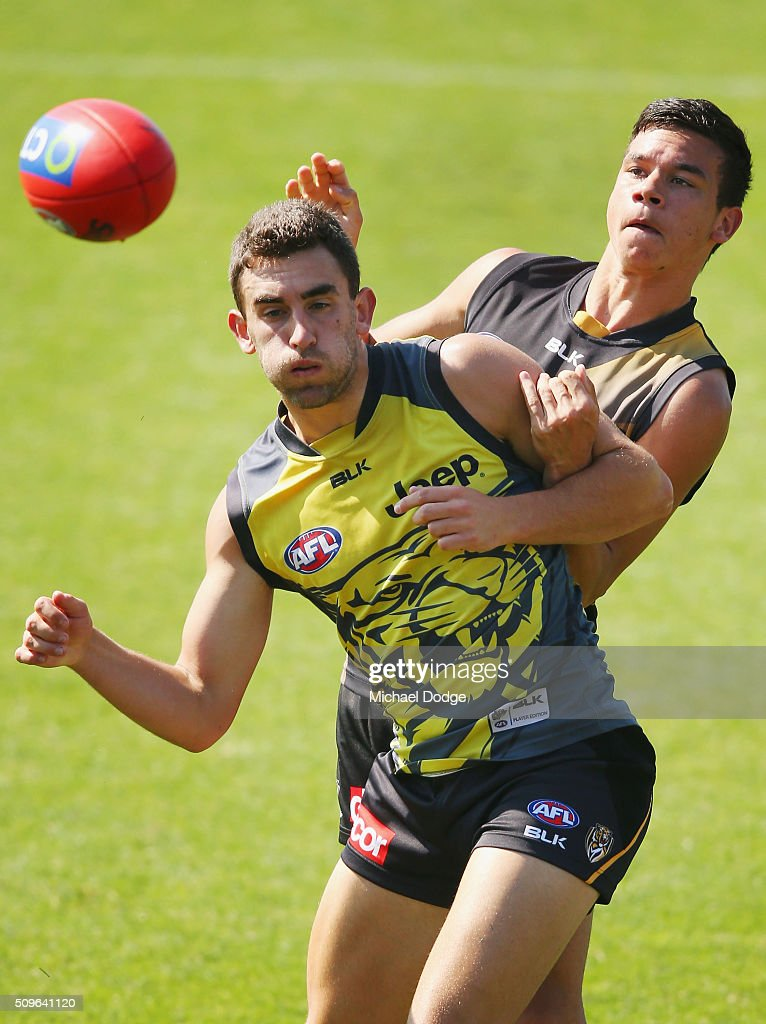 Daniel Rioli of the Tigers tackles Adam Marcon of the Tigers during the Richmond Tigers AFL intra-club match at Punt Road Oval on February 12, 2016 in Melbourne, Australia.