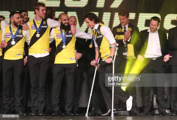 Daniel Rioli of the Tigers walks on stage on crutches as the Tigers celebrate with the AFL Premiership Cup on stage during the Richmond Tigers AFL...