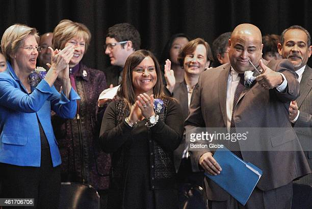 Daniel Rivera right acknowledged a standing ovation before his swearingin as mayor of Lawrence Saturday Jan 4 2014 On hand were US Sen Elizabeth...
