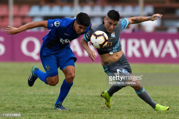 Daniel Rivillo of Venezuela's Zulia and Christian Ortiz of Peru's Sporting Cristal vie for the ball during their Copa Sudamericana football match...