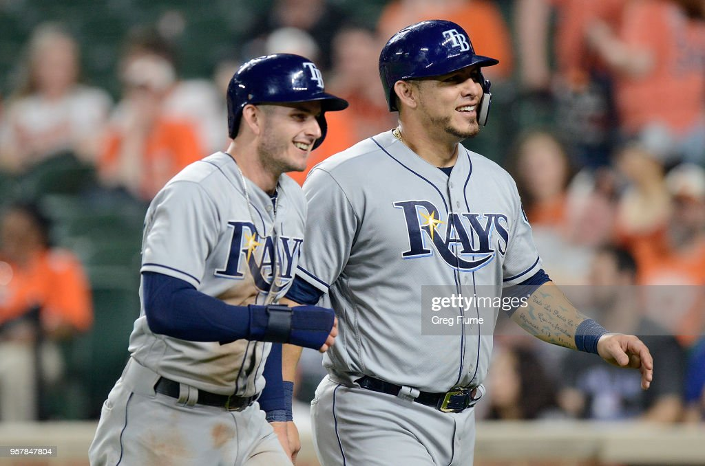 Daniel Robertson #28 and Wilson Ramos #40 of the Tampa Bay Rays celebrate after scoring in the ninth inning against the Baltimore Orioles during the second game of a doubleheader at Oriole Park at Camden Yards on May 12, 2018 in Baltimore, Maryland.