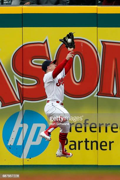 Daniel Robertson of the Cleveland Indians makes a leaping catch to get out Scott Schebler of the Cincinnati Reds during the second inning at...
