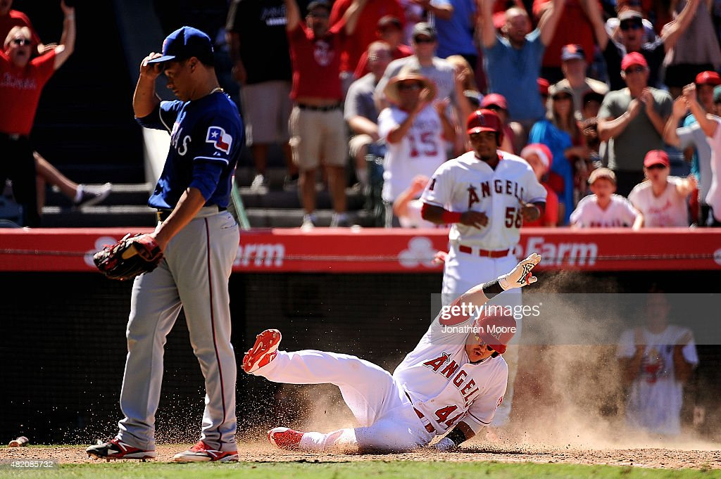 Daniel Robertson #44 of the Los Angeles Angels of Anaheim scores on a throwing error by Rougned Odor #12 of the Texas Rangers (not pictured) after hitting an infield home run in the seventh inning during a game at Angel Stadium of Anaheim on July 26, 2015 in Anaheim, California.