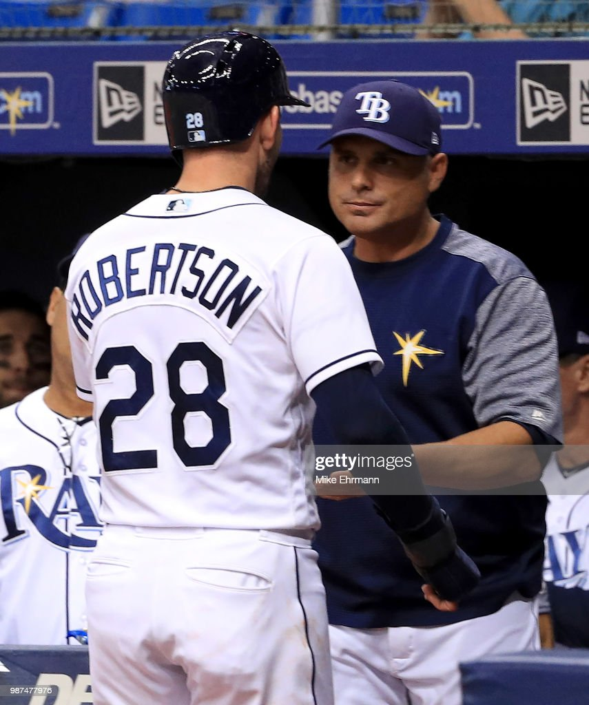 Daniel Robertson #28 of the Tampa Bay Rays is congratulated after scoring a run by manager Kevin Cash #16 during a game at Tropicana Field on June 29, 2018 in St Petersburg, Florida.