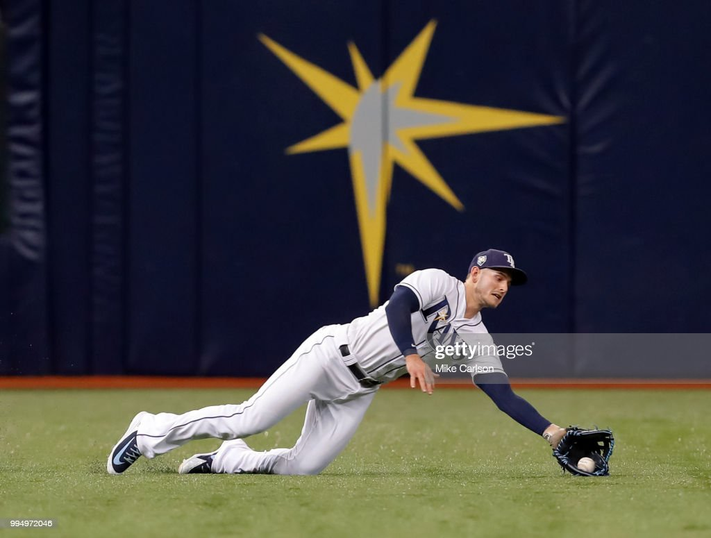 Daniel Robertson #28 of the Tampa Bay Rays makes a diving catch on a fly ball from Mikie Mahtook #8 of the Detroit Tigers in the third inning of a baseball game at Tropicana Field on July 9, 2018 in St. Petersburg, Florida.