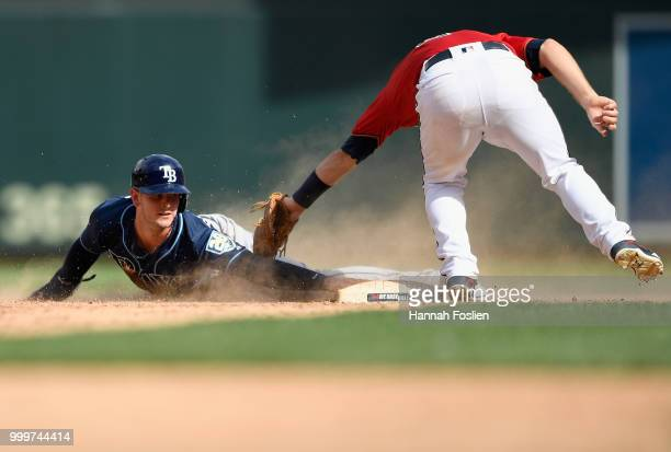 Daniel Robertson of the Tampa Bay Rays steals second base against Brian Dozier of the Minnesota Twins during the ninth inning of the game on July 15...
