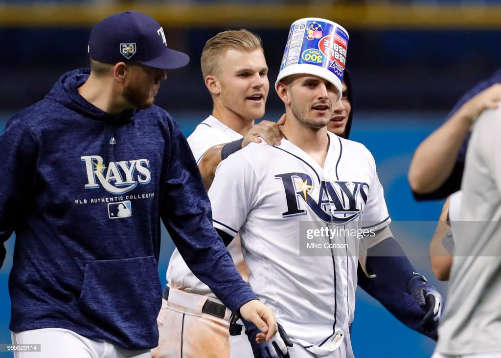 Daniel Robertson #28 of the Tampa Bay Rays, with the bucket, is congratulated by Jake Bauers #9 after his game-winning hit in the 10th inning of a baseball game against the Detroit Tigersat Tropicana Field on July 9, 2018 in St. Petersburg, Florida.